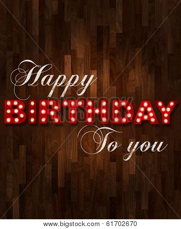 Parquet floor background with glowing letters writing Happy Birthday to you