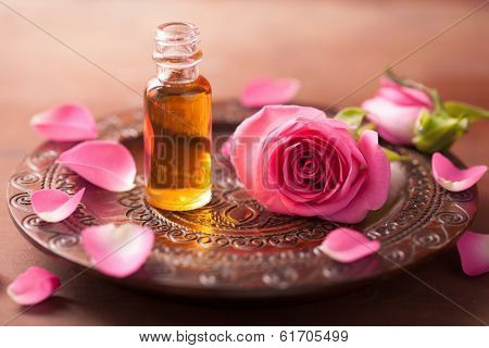 rose flower and essential oil. spa and aromatherapy