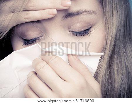 Flu Fever. Sick Girl Sneezing In Tissue. Health