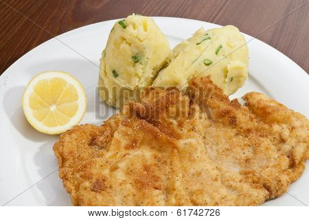 Vienna Schnitzel With Mashed Potatoes And Baby Onion
