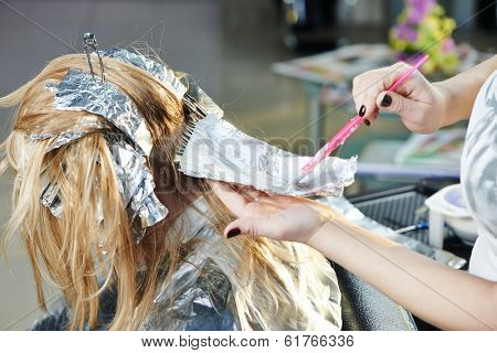 Highlight. Washing woman client hair in beauty parlour hairdressing salon