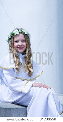 First Communion beautiful young girl on the white background
