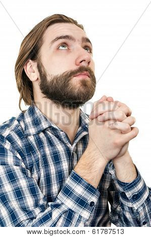 the young man with a beard prays to god