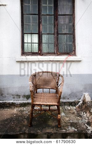 Abandoned Wicker Chair In The Pingjiang District Of Suzhou, China