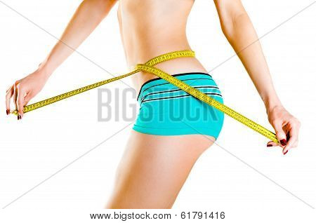 Slim  woman measuring waist isolated on white background poster