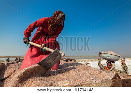 SAMBHAR, INDIA - NOVEMBER 19, 2012: Women mining salt at lake Sambhar, Rajasthan, India. Sambhar Salt Lake is India's largest inland salt lake