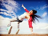 sport, dancing and urban culture concept - beautiful dancing girl in movement poster