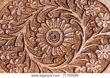 Close-up of artistic carving on wooden jewel box poster