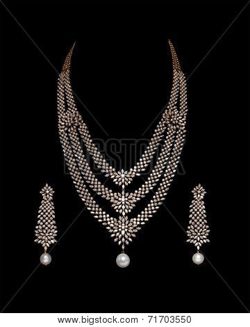 Close up of diamond necklace with diamond earrings