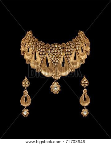 Close up of gold and diamond necklace with earrings
