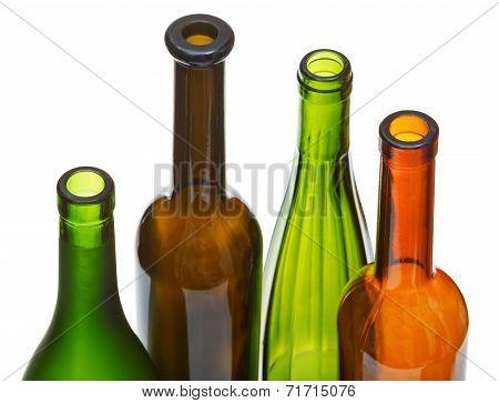 Four Open Bottlenecks Of Colored Wine Bottles
