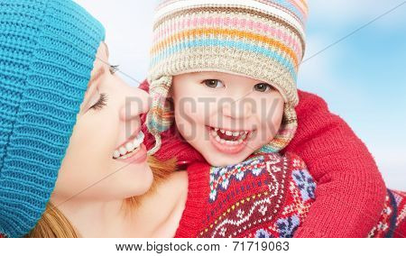 Happy Family Mother And Baby Little Daughter Playing In Winter