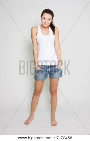 Young Attractive Girl Standing Over White