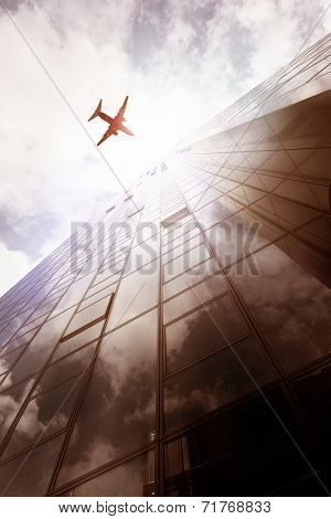 plane flying over an office building in Frankfurt am Main, Germany poster