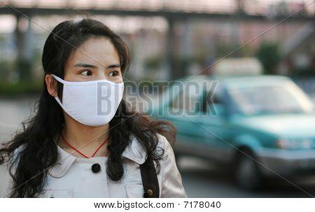 Asian woman wearing a face mask