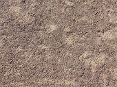 fine texture of brown gravel on a dirt road poster