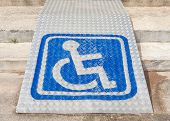 The blue sign indicating on wheelchair usage on steel ramp for disabled people. poster
