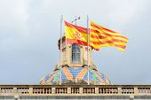Flag of Spain and Flag of Catalonia at the top of Palau de la Generalitat de Catalunya, the Old City (Ciutat Vella) of Barcelona, Catalonia, Spain. poster