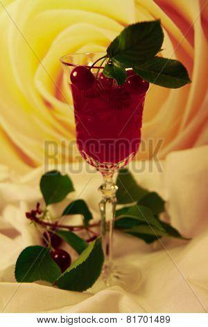 cherry and glass of wine
