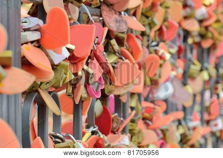The Key To Hundreds Of Old Symbol Of Love . Locked To The Rack -focus Blur.