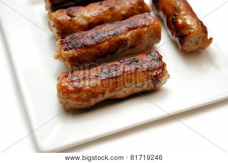 Fried Breakfast Link Sausage On A White Plate