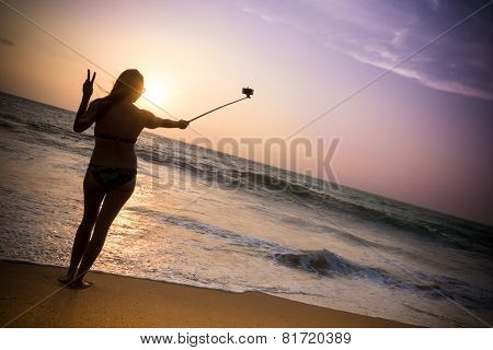 Surfer Chick Takes Selfie On Beach At Sunset