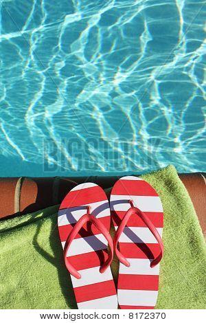 Flip flops by swimming pool