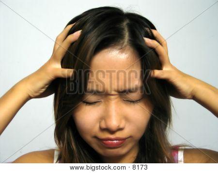 Asian Girl With A Headache