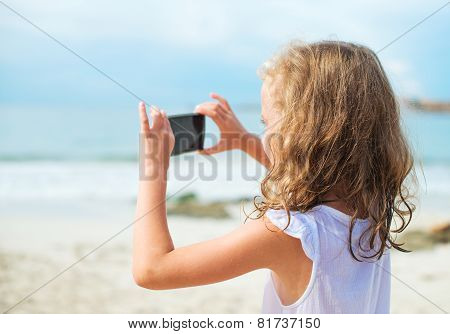 Little Girl Making Video Or Photo With Mobile Phone.