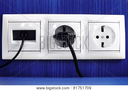 Plugs In Electric And Phone  Socket.