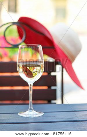 Glass Of Delicious White Wine In Summer Restaurant. Outdoors.