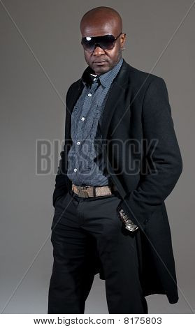 Happy Black Man Well Dressed Smiling On Gray Background