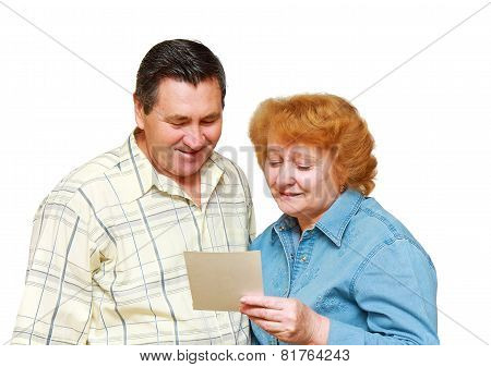 Old Couple  Look At  Family Picture With Gladness.