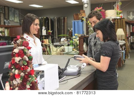 A home design shop with employee clerk poster