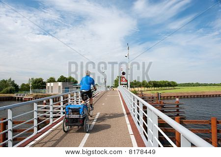 active elderly man with his doggy ride on the bike poster