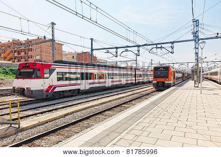 Suburban railway train at the railways station. Spain Catalonia. poster
