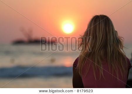 Blond Woman Watching Sunset In Puerto Escondido, Mexico