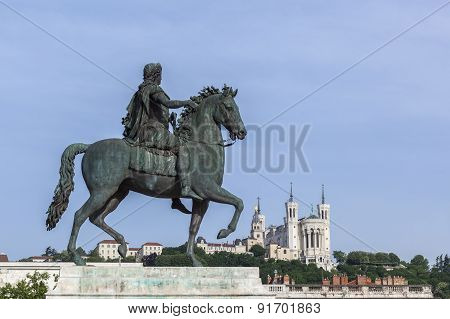 Statue And Fourviere Basilica On A Background