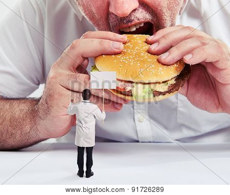 close up photo of man eating burger with french fries and small doctor looking at him and protesting against junk food