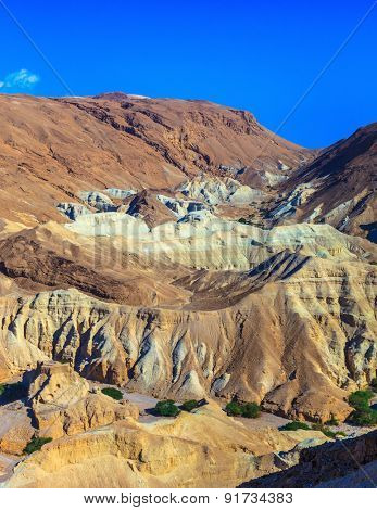 Picturesque multi-colored taluses dry sandstone. Ancient mountains in the valley of the Dead Sea