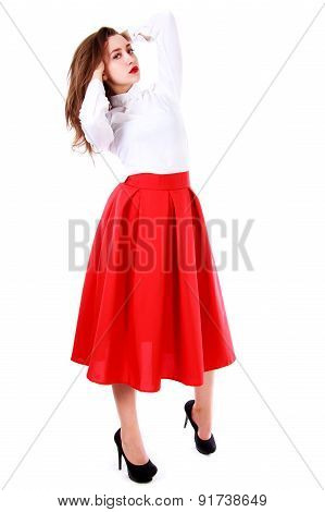 Beautiful Young Woman In A White Blouse And A Long Red Skirt