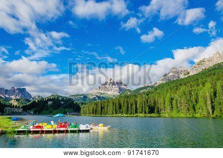 Colored pedalos on Lake Misurina, Dolomites, Italy