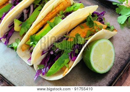 Fish tacos with red cabbage lime slaw