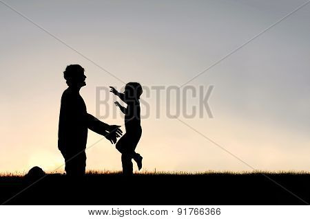 Happy Young Child Running To Greet Dad Silhouette