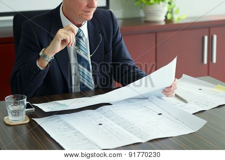 Investor With Blueprint