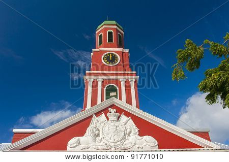 Famous red clock tower on the main guardhouse at the Garrison Savannah. UNESCO garrison historic area Bridgetown, Barbados