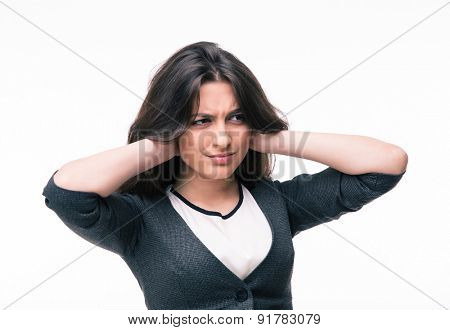 Businesswoman covering her ears with hands isolated on a white background. Looking away