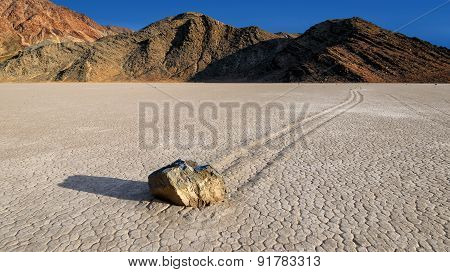 Sailing Rocks at Racetrack Playa, Death Vally National Park. Sailing Rocks leave trails on the Racetrack. poster