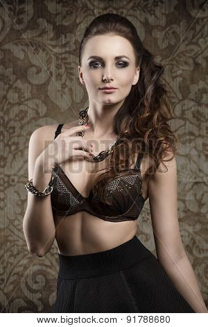 fashion brunette woman posing with cute bra and black skirt. Stylish make-up and modern wavy hair-style. Charming expression poster