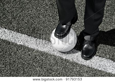 Manager with Soccer Ball on the Touchline